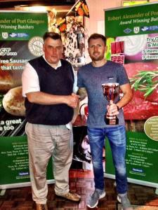 Drew McKenzie presents Andrew Harkins with his trophy
